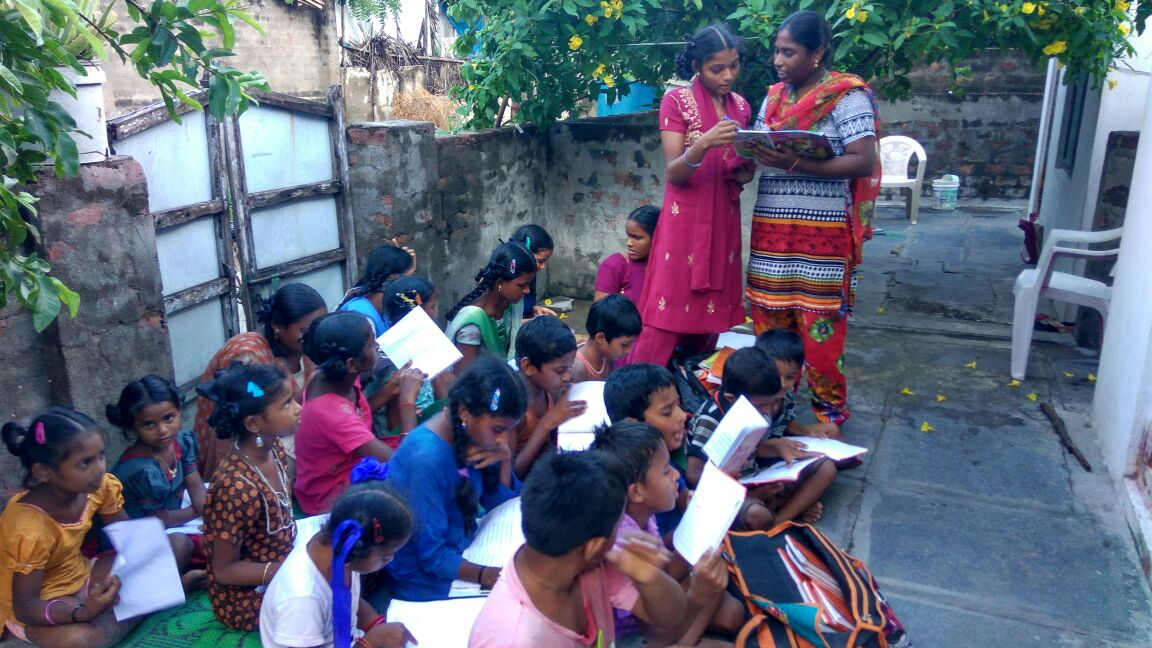 Vasavi-conducting_tuitions_-_standing_right